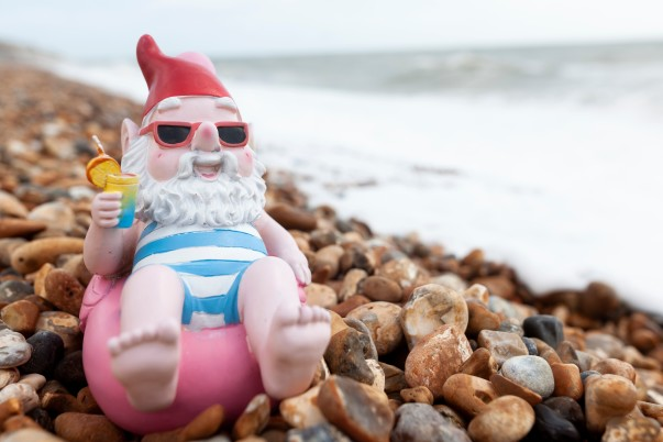 An Asda gnome relaxes by the sea