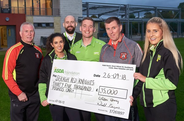 Asda Omagh colleagues present the cheque to Beragh Red Knights GAA
