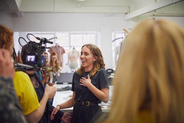 Fashion graduate Megan Grinham is told the good news at uni