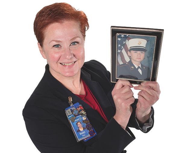 Sherri Eiler Holding Old Photo In Uniform