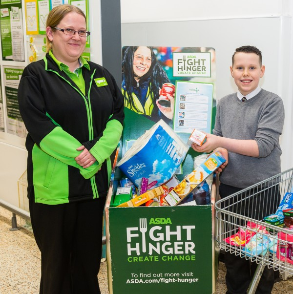 Kayden Smith has used his pocket money at Asda Dundee Kirkton donating to Dundee Foodbank