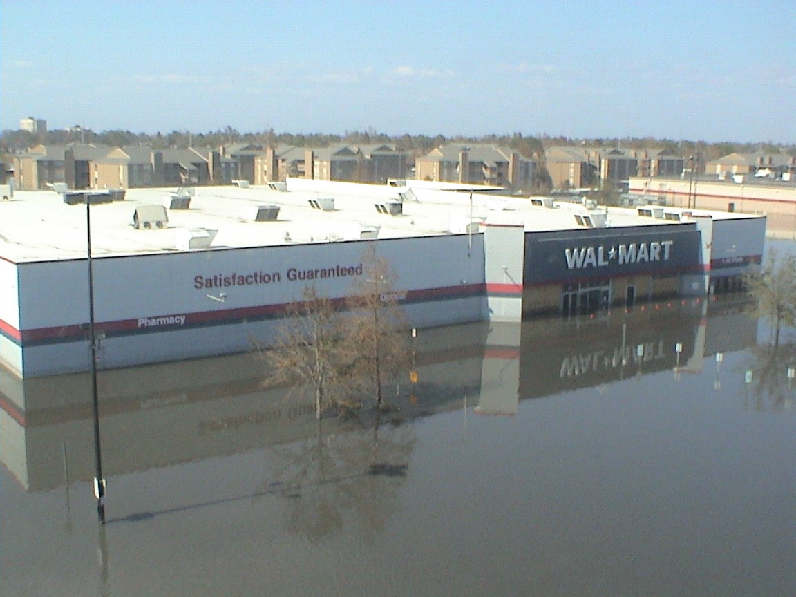 A parking lot of a Walmart store is flooded