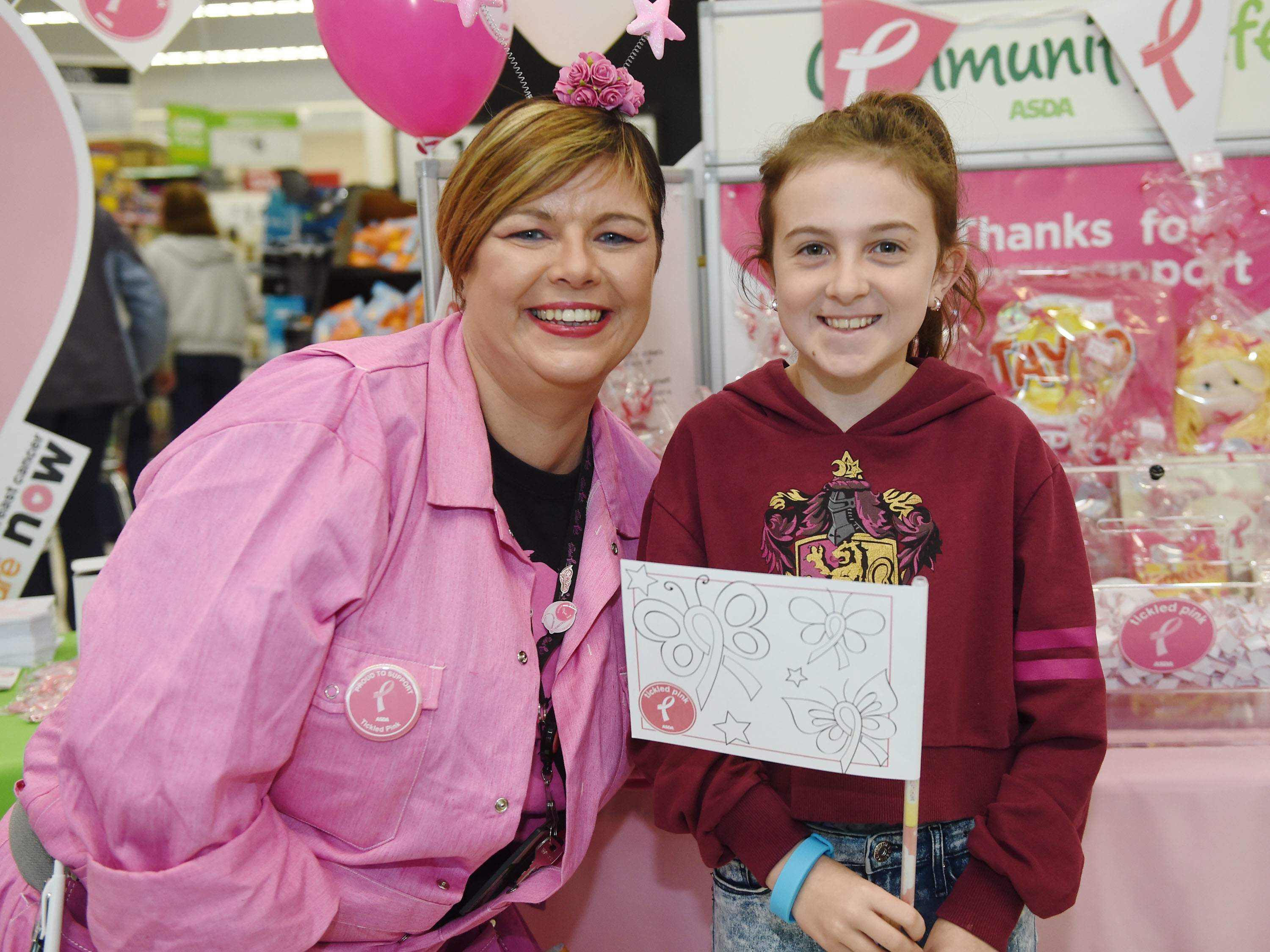 Catherine and a young customer get behind Tickled Pink 2017