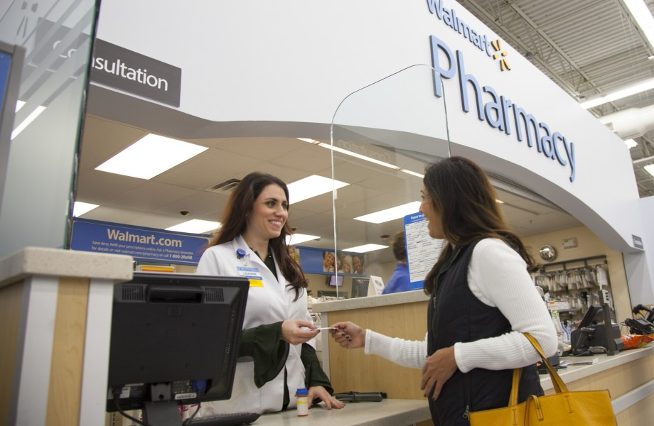 Pharmacist consulting customer at pharmacy