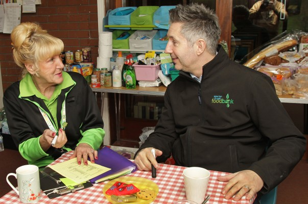 Asda Leigh community champion Gwen with Warren from the foodbank