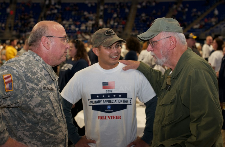 Three veterans talking to each other