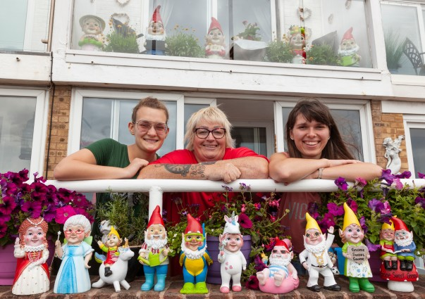 Janet Wilson and her daughters Adel and Karina with their collection of Asda gnomes.