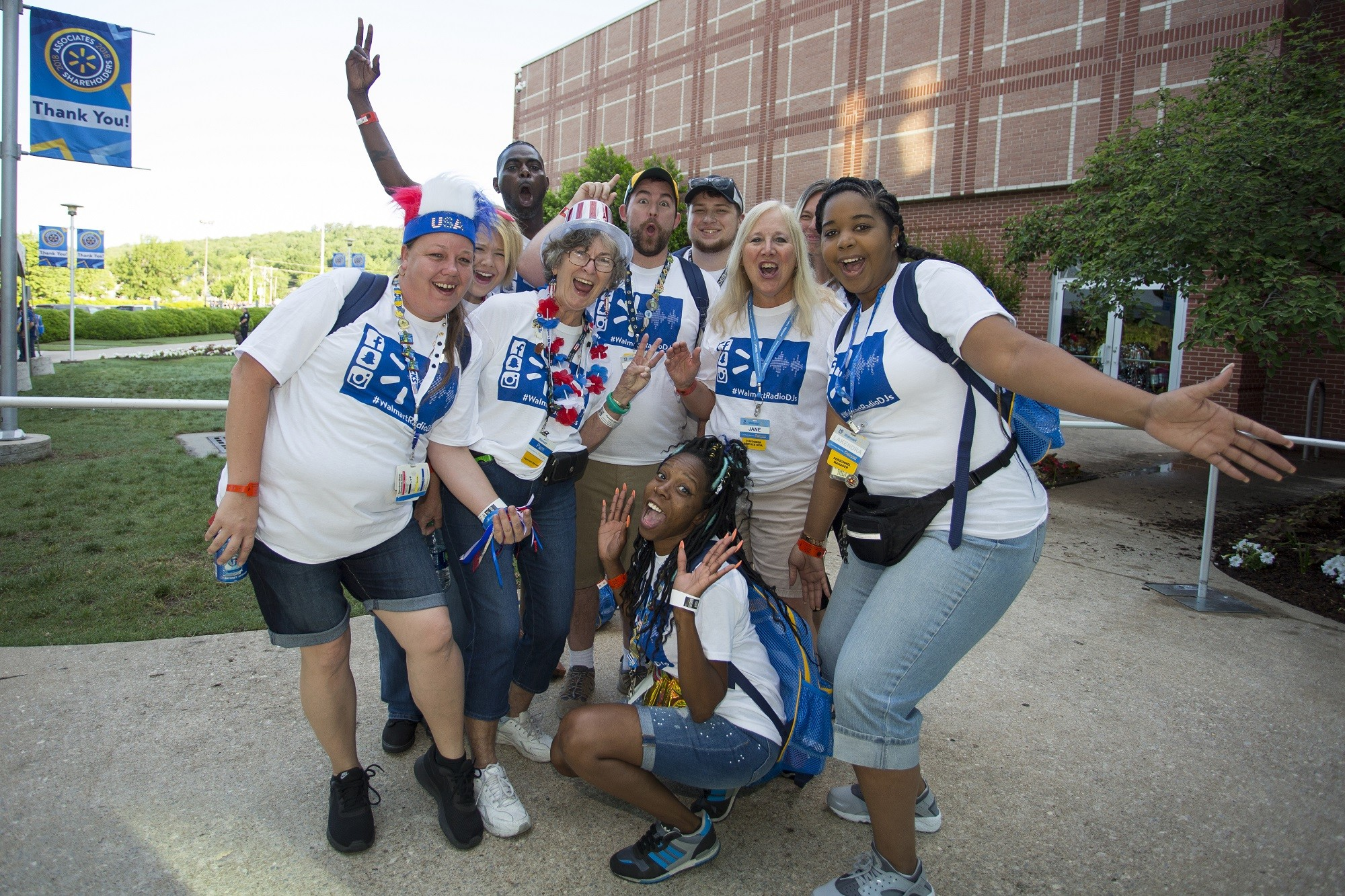 Associates wait to enter the Bud Walton Arena for the U.S. Associates Meeting during Shareholders 2018