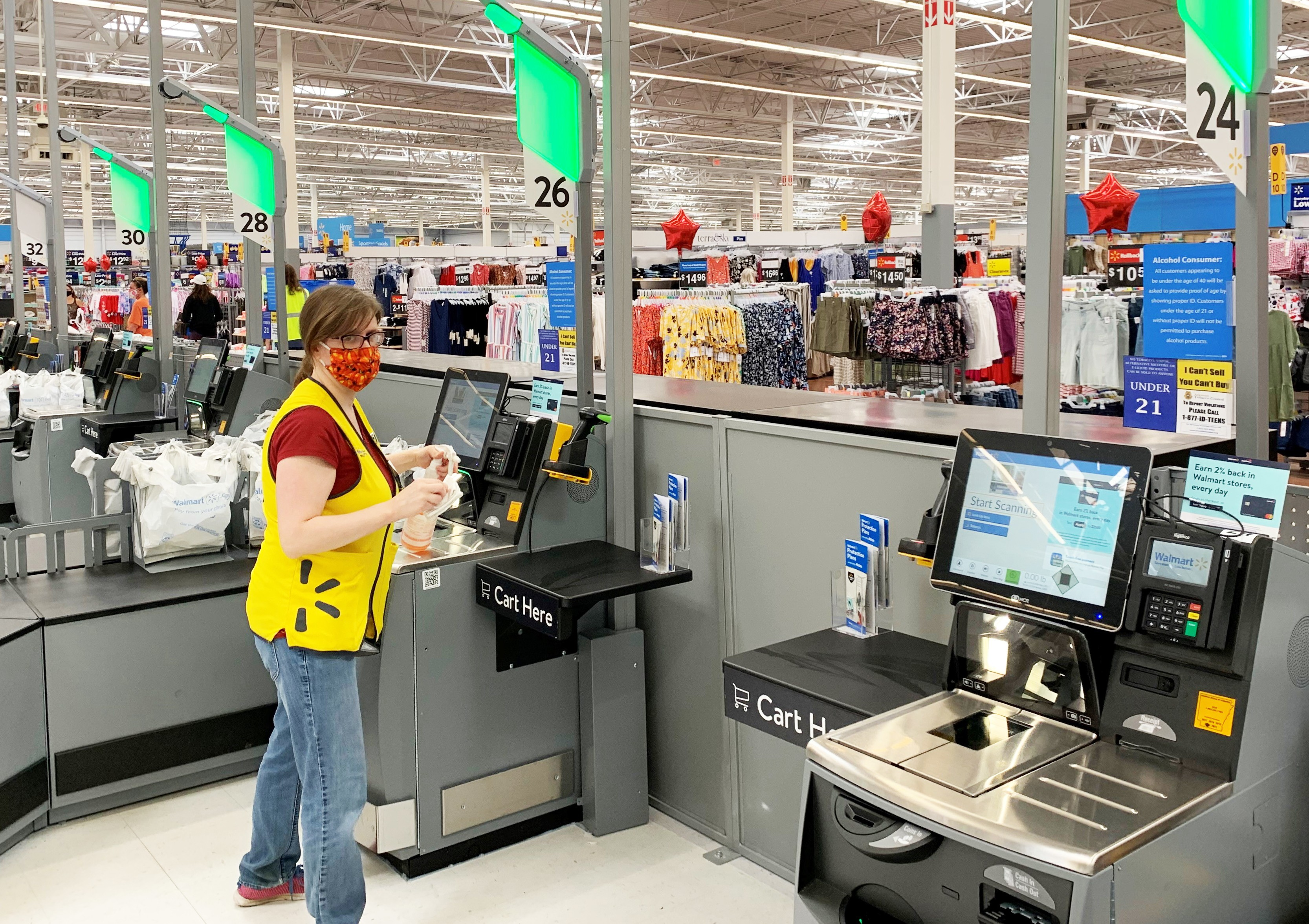 Associate in mask cleaning self checkout