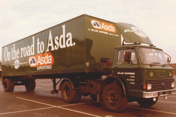 "Historical semi truck with ""On the road to Asda"" written on the side"