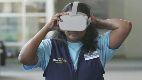 Associate Sandra puts on an Oculus VR Headset