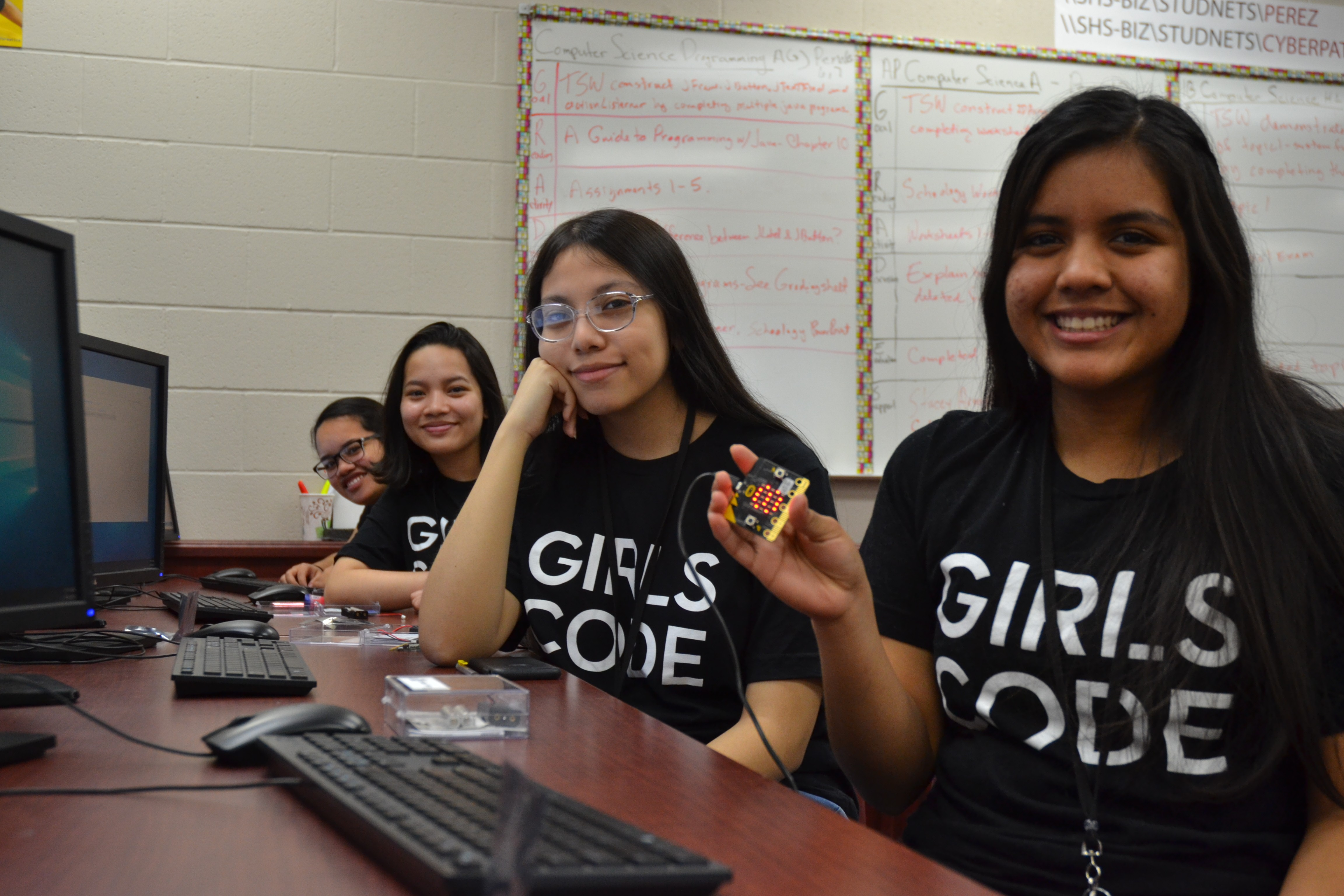 Members of Girls Who Code work on a project