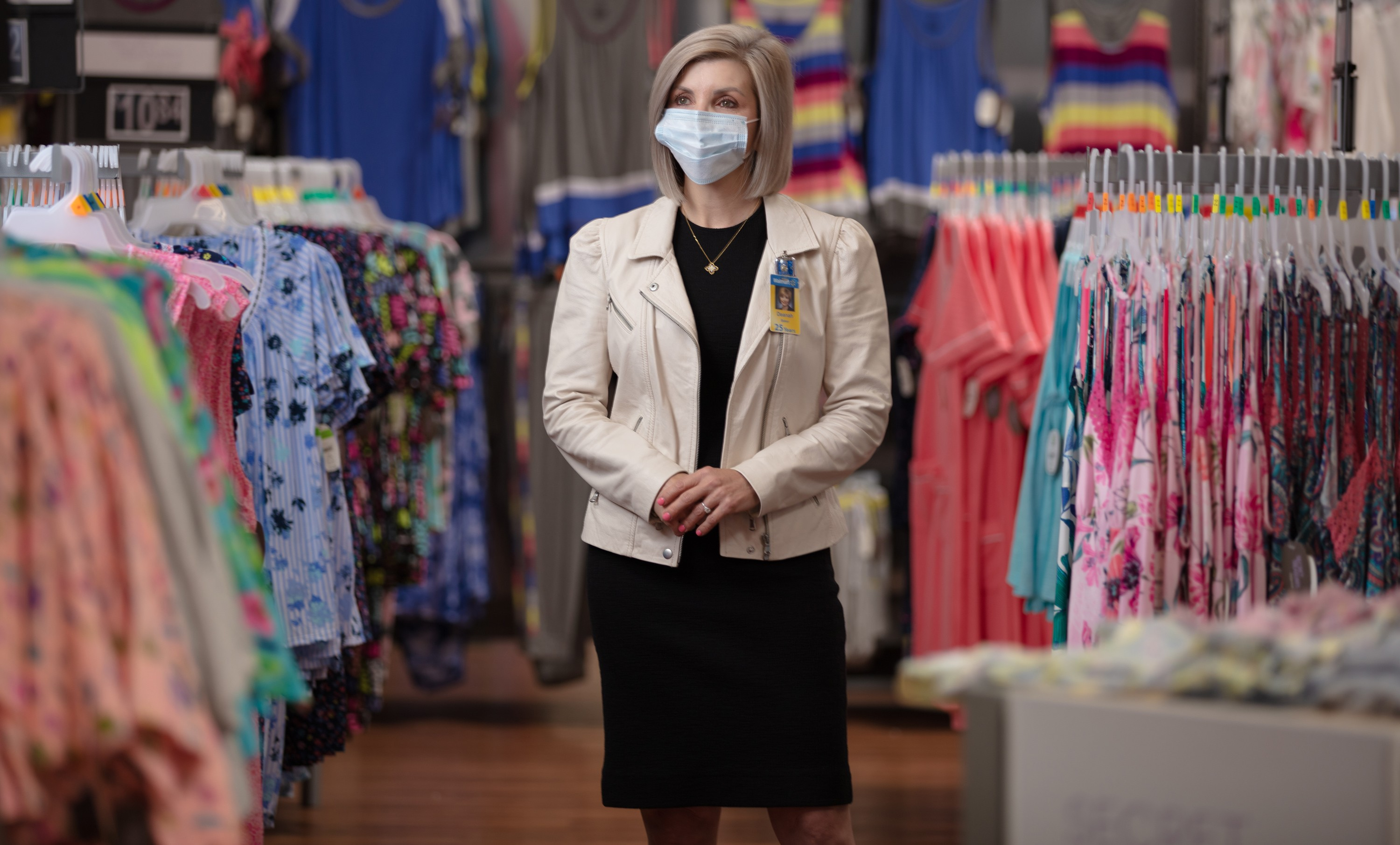 Deanah Baker, senior vice president for apparel, wears a mask in the apparel department