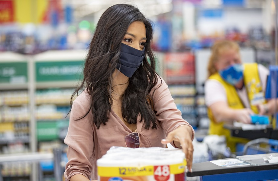 Customer wearing masks at checkout