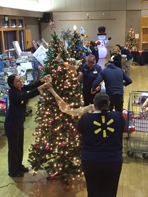 Associates decorating a Christmas tree