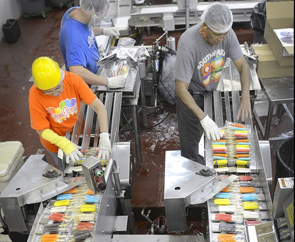 Twin Pops Factory with Workers on Production Line