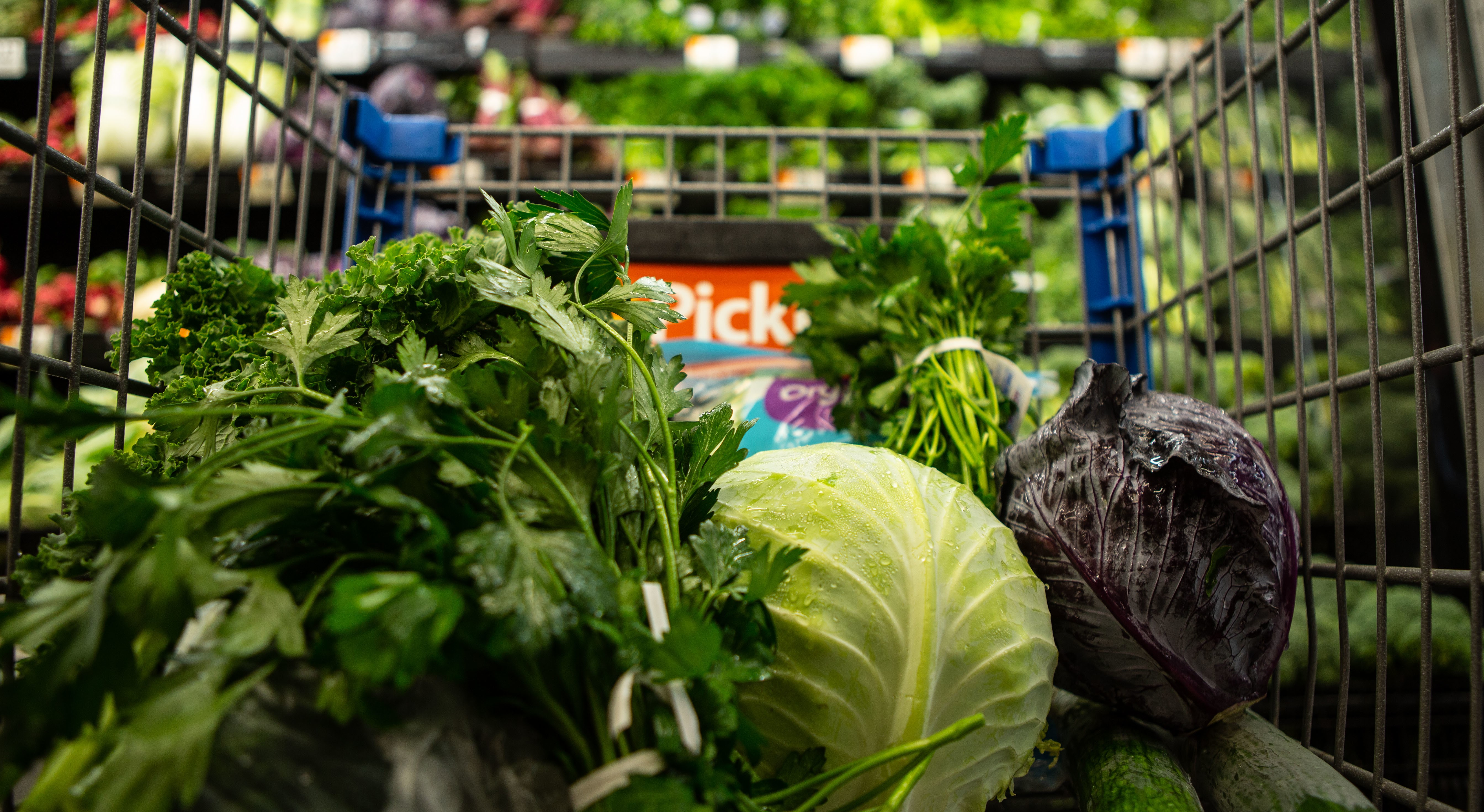 Lettuce and fresh produce in a shopping cart