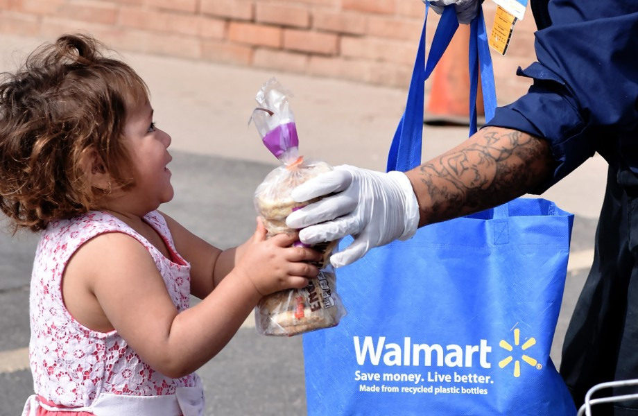 Associate gives bagels to a child