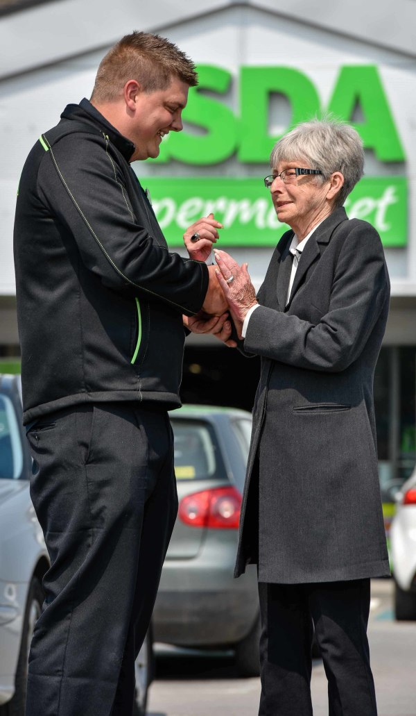 Asda Royston colleague Scott Lettin with customer Dot Broadley