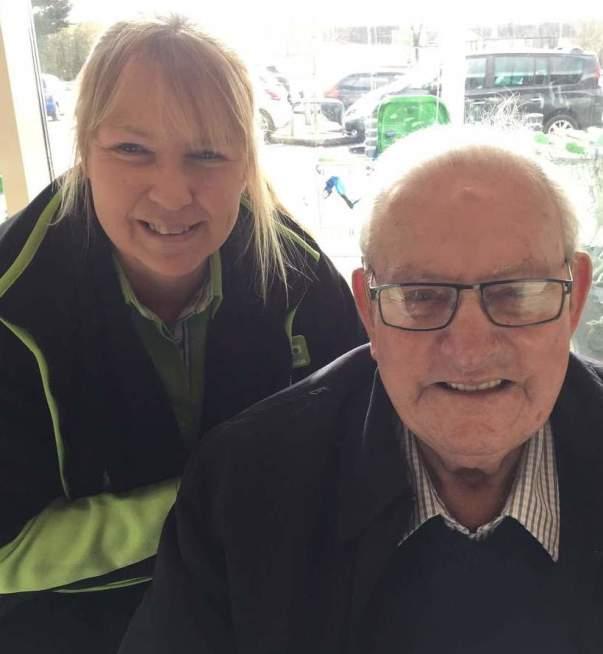 Asda Llangefni customer Norman with colleague Wendy
