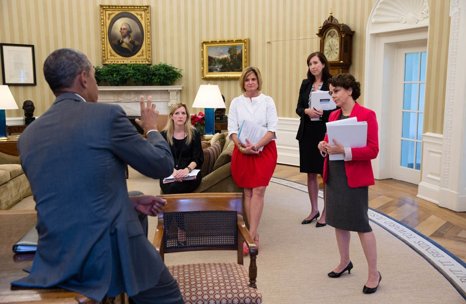 Cecilia Munoz and other women stand in a conference room in the White House