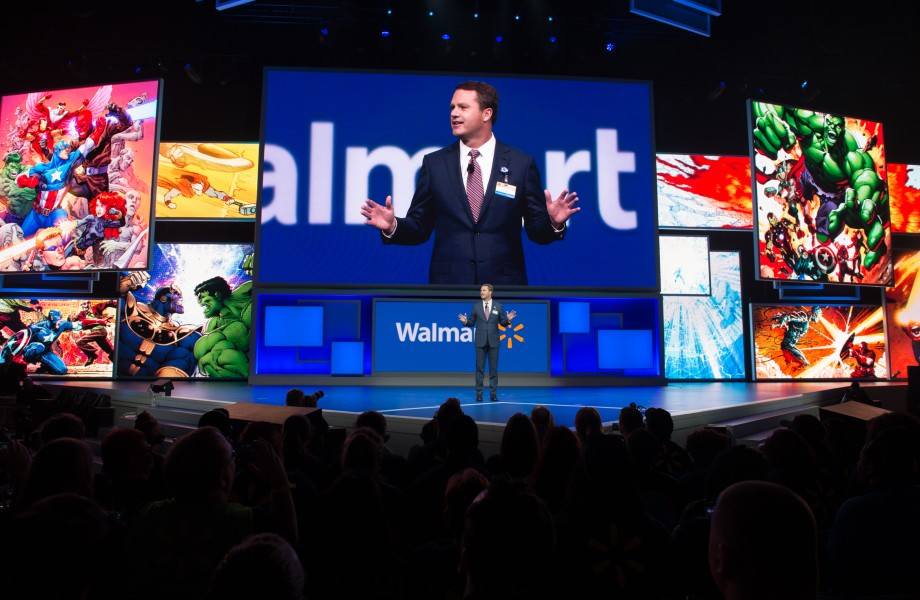 Walmart President and CEO Doug McMillon with Superhero Background at the 2015 Walmart Shareholders Meeting