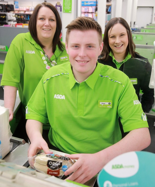 Tor Bank School pupil Conor McSherry with colleagues at Asda Dundonald