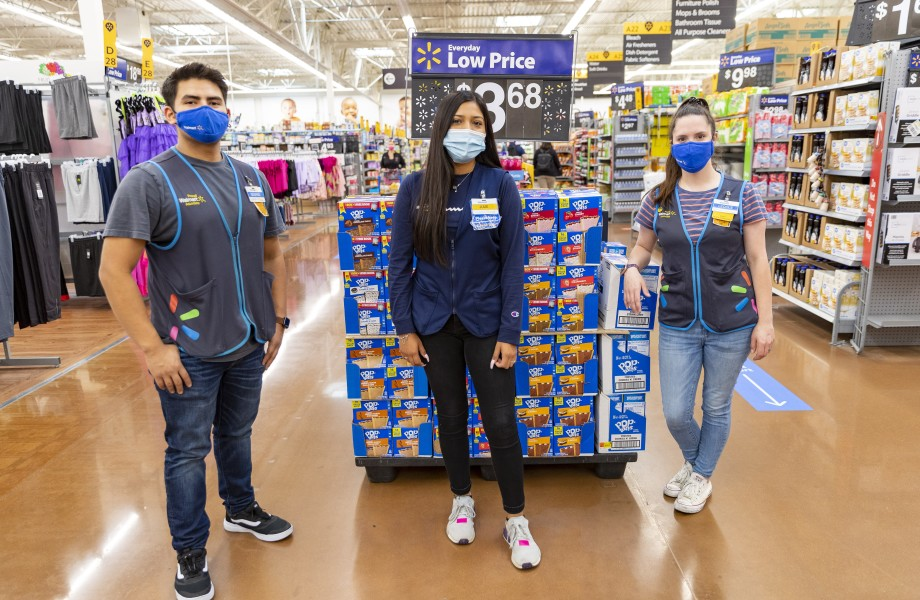 Associates with masks standing in front of Poptarts
