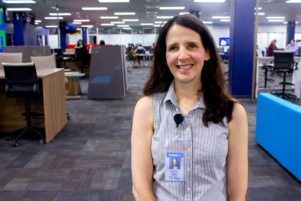 Walmart eCommerce associate Carrie Farber smiles inside the Walmart eCommerce office