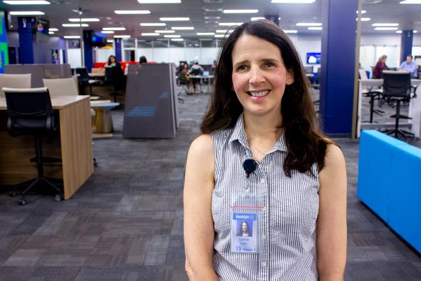 Walmart eCommerce associate Carrie Farber smiles inside the Walmart eCommerce office