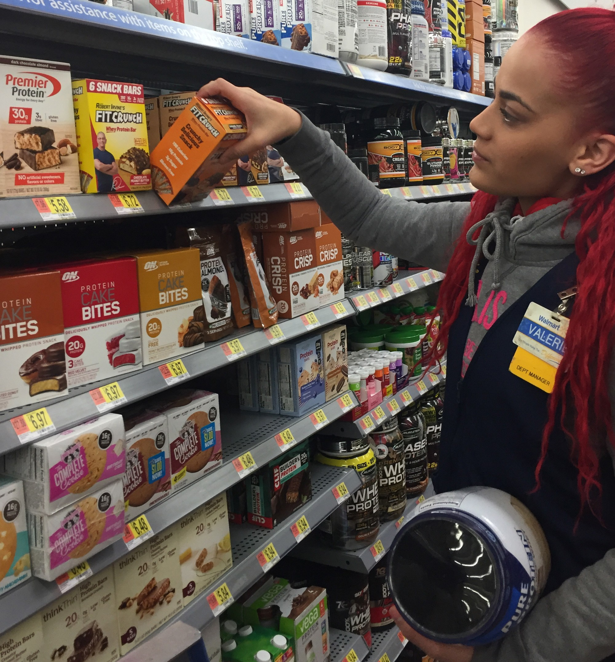 An associate stocks protein bars in a Walmart Supercenter in Secaucus, New Jersey
