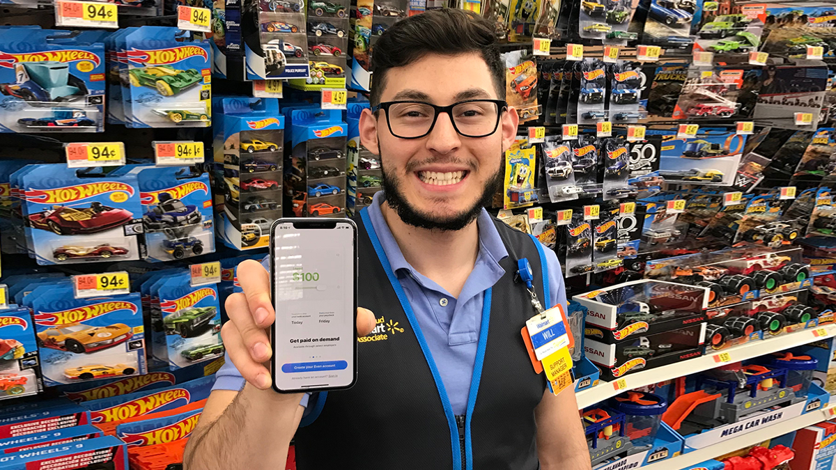 Associate holding phone with Even app