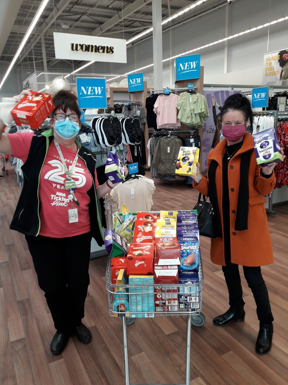 Dundee bairns receiving a donation of Easter eggs for local children. | Asda Dundee West