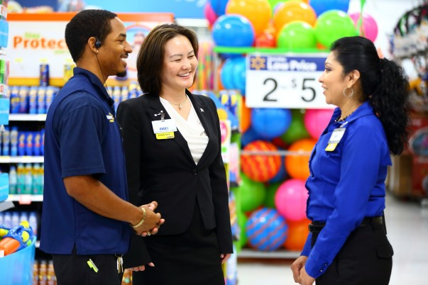 Store Manager Bogey Say with Two Associates