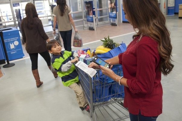 A customer scans her receipt on her Walmart.com app