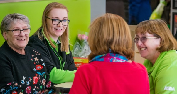 Colleagues Charlotte Earps and Cathy Robinson chat to guests at Asda Warrington's community friendship group