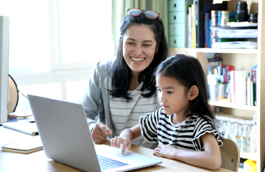 Customer and child sitting at laptop