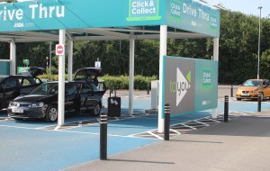 A drive thru area has several stalls for parked cars to wait for customers' Click & Collect items