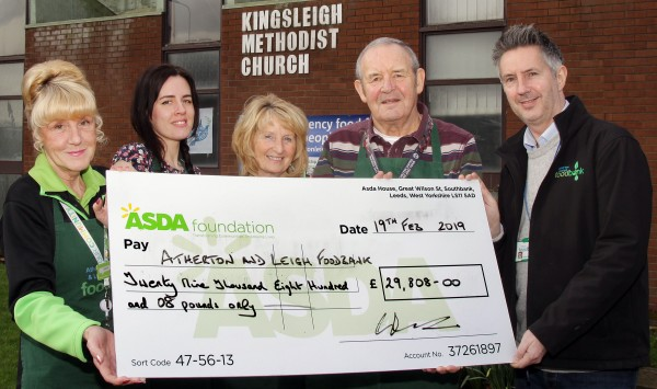 Asda Leigh community champion Gwen with the foodbank's cheque