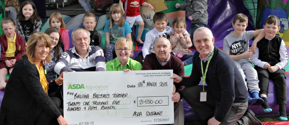 Former Asda Coleraine community champion Sheila Palmer with an Asda Foundation cheque for Building Ballysally Together