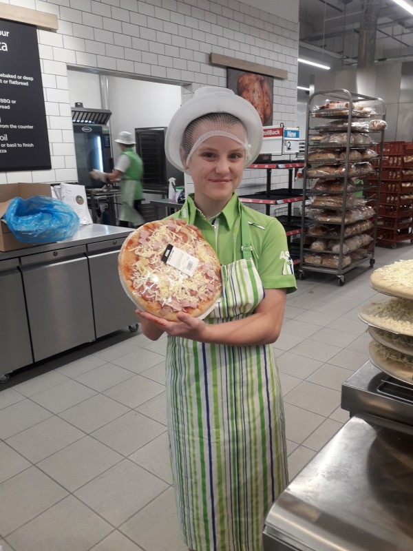Melissa Taylor-Grounsell with the pizza she made on her day helping at Asda Isle of Wight