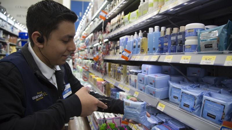 an associate scans personal care items for grocery pickup