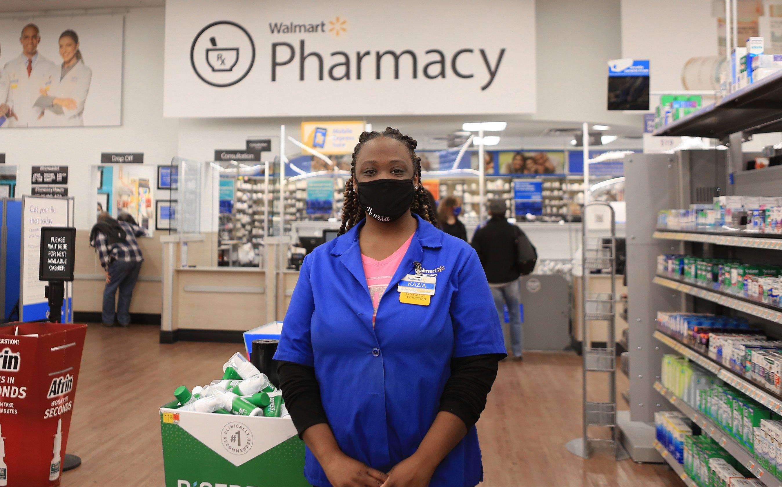 Associate Posing in Front of Pharmacy
