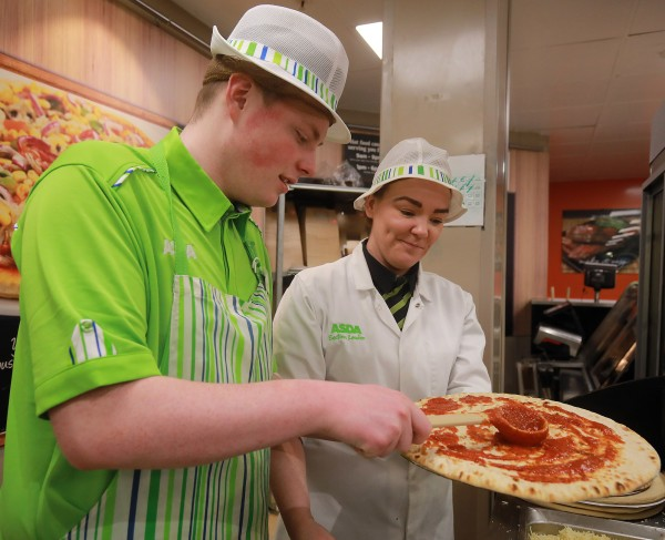 Tor Bank School pupil Conor McSherry makes a pizza during a placement at Asda Dundonald