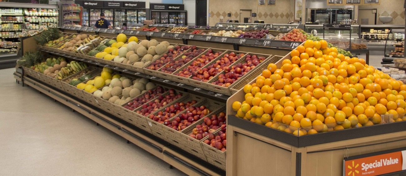 Baskets of fresh fruit and vegetables fill a product department