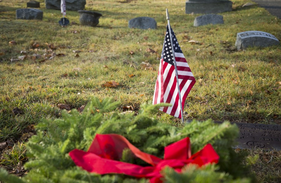 American Flag on Gravesite with Christmas Wreath laying