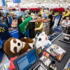 Customers stock up on TVs, electronics, toys and home goods at Walmart's Black Friday store event on Thursday, Nov. 22, 2018 in Bentonville, Ark.