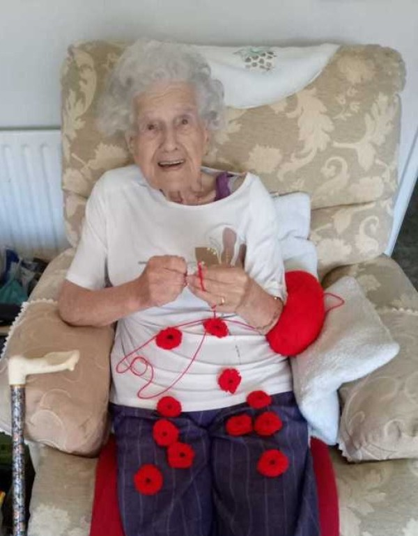 Asda Worcester customer Beatrice Furlong knits poppies for the Royal British Legion