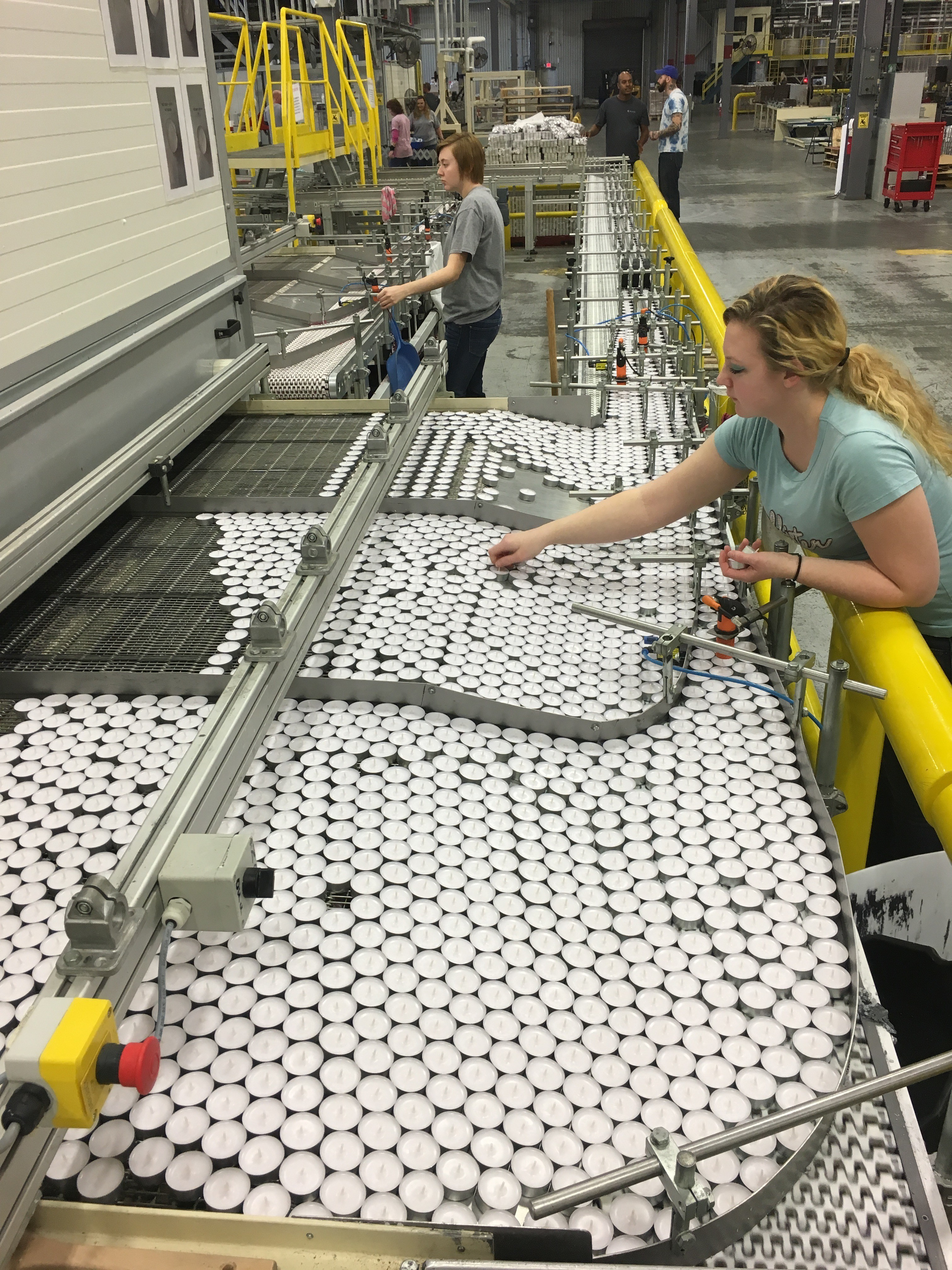 Worker in a Korona Candles factory