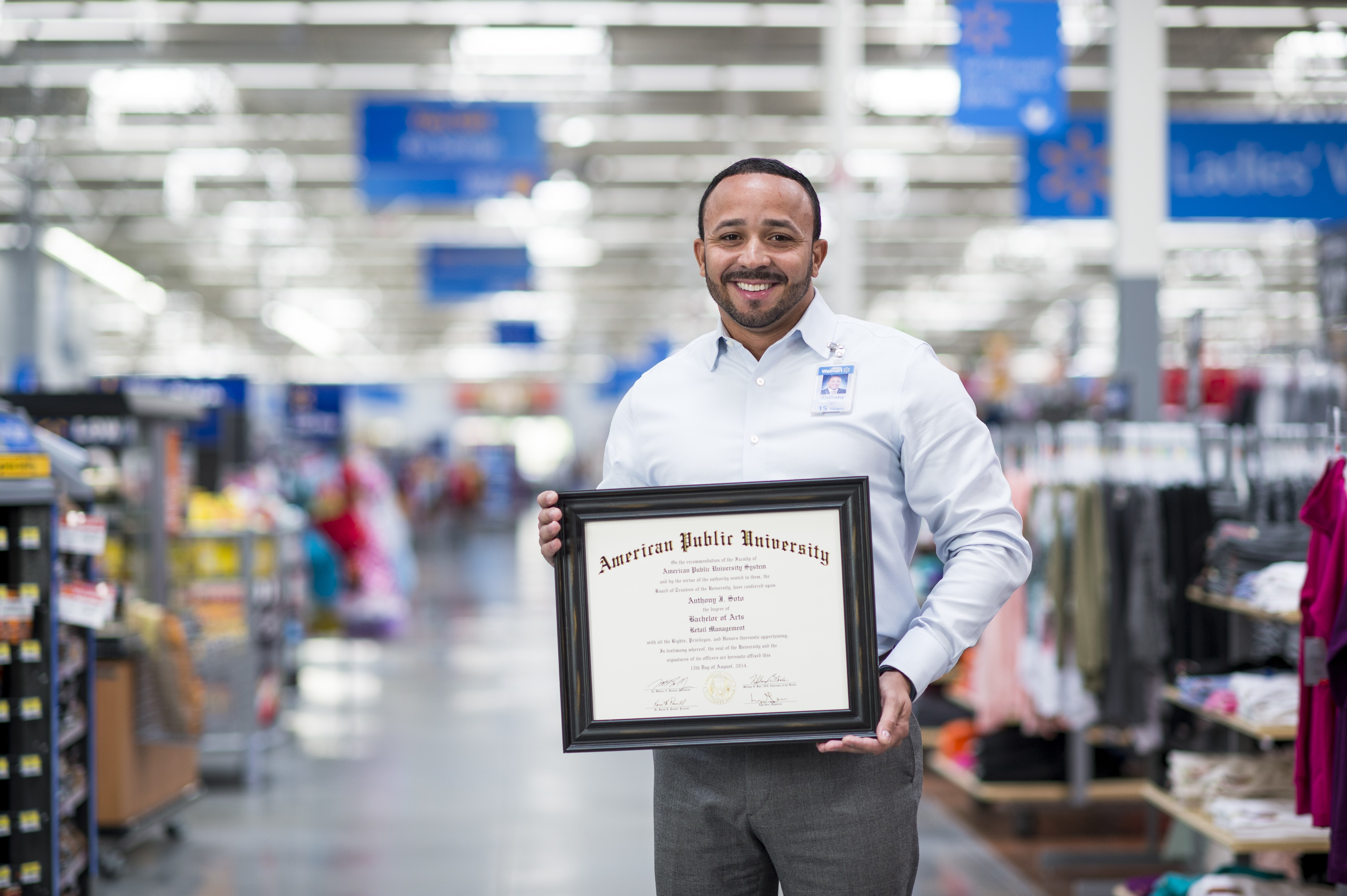 Anthony In Store Holding Diploma